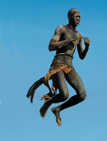 Leaping Dinka Dancer, South Sudan by Carol Beckwith and Angela Fisher