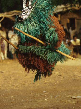 Leaping Bobo Bush mask dancer by Carol Beckwith and Angela Fisher