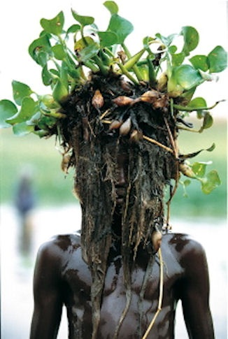 Dinka wearing Water Hyacinth, South Sudan by Carol Beckwith and Angela Fisher