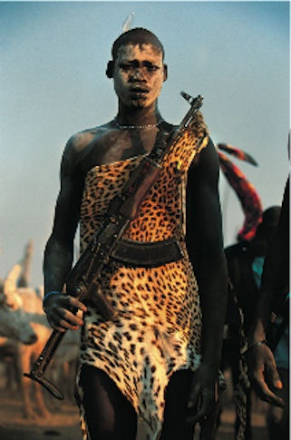 Dinka Man with Kalashnikov, South Sudan by Carol Beckwith and Angela Fisher
