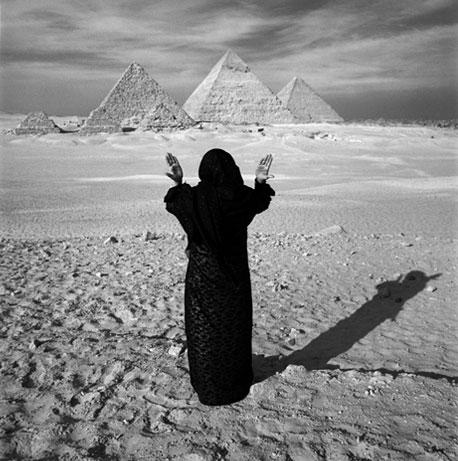 Bedouin Woman Pays Tribute to Pyramids by Chris Rainier