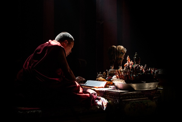 Lama Ngawang Kunga Praying During the Creation of a Sand Mandala in Thupchen by Luigi Fieni