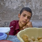 Boy selling vegetables, Qom