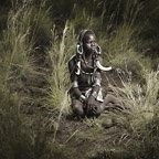 Mursi Boy in Tall Grass