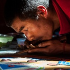 Monk Applying Colored Sand to Sand Mandala
